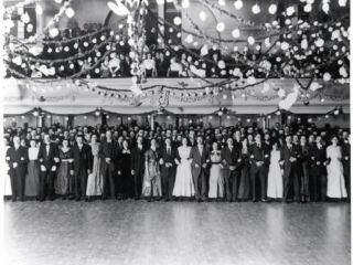 A Group Of People Standing In Front Of A Crowd